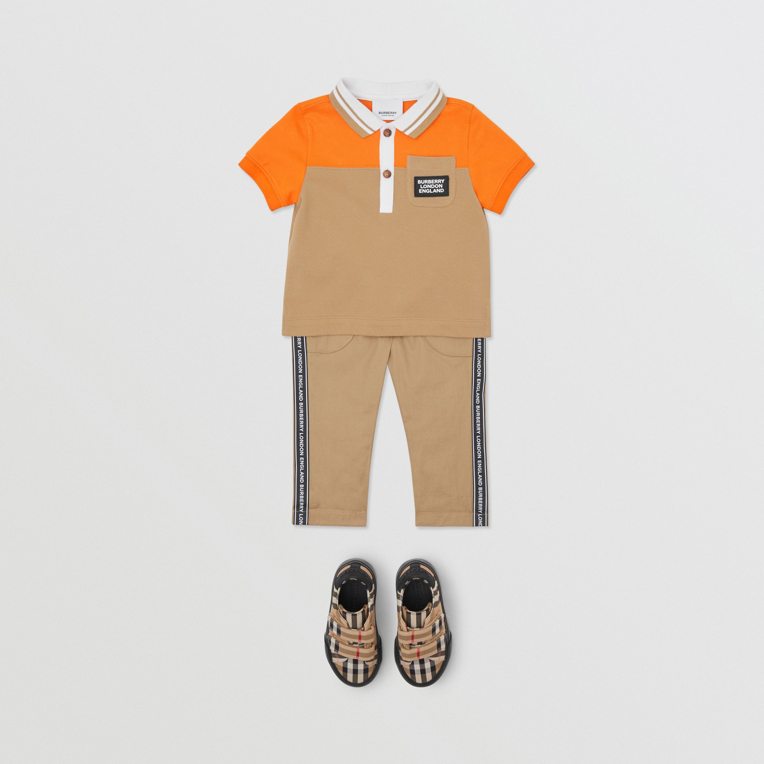 Colour Block Cotton Piqué Polo Shirt in Bright Mandarin - Children | Burberry - 3