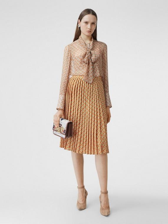 Monogram Print Crepe De Chine Pleated Skirt in Bright Orange