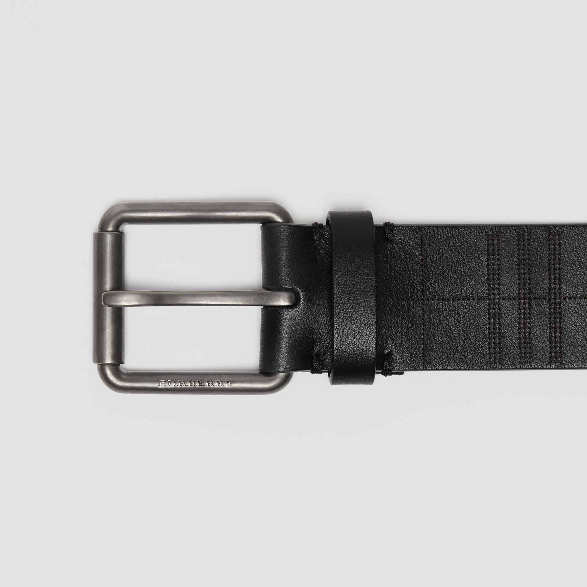 Perforated Check Leather Belt in Black - Men | Burberry - gallery image 1