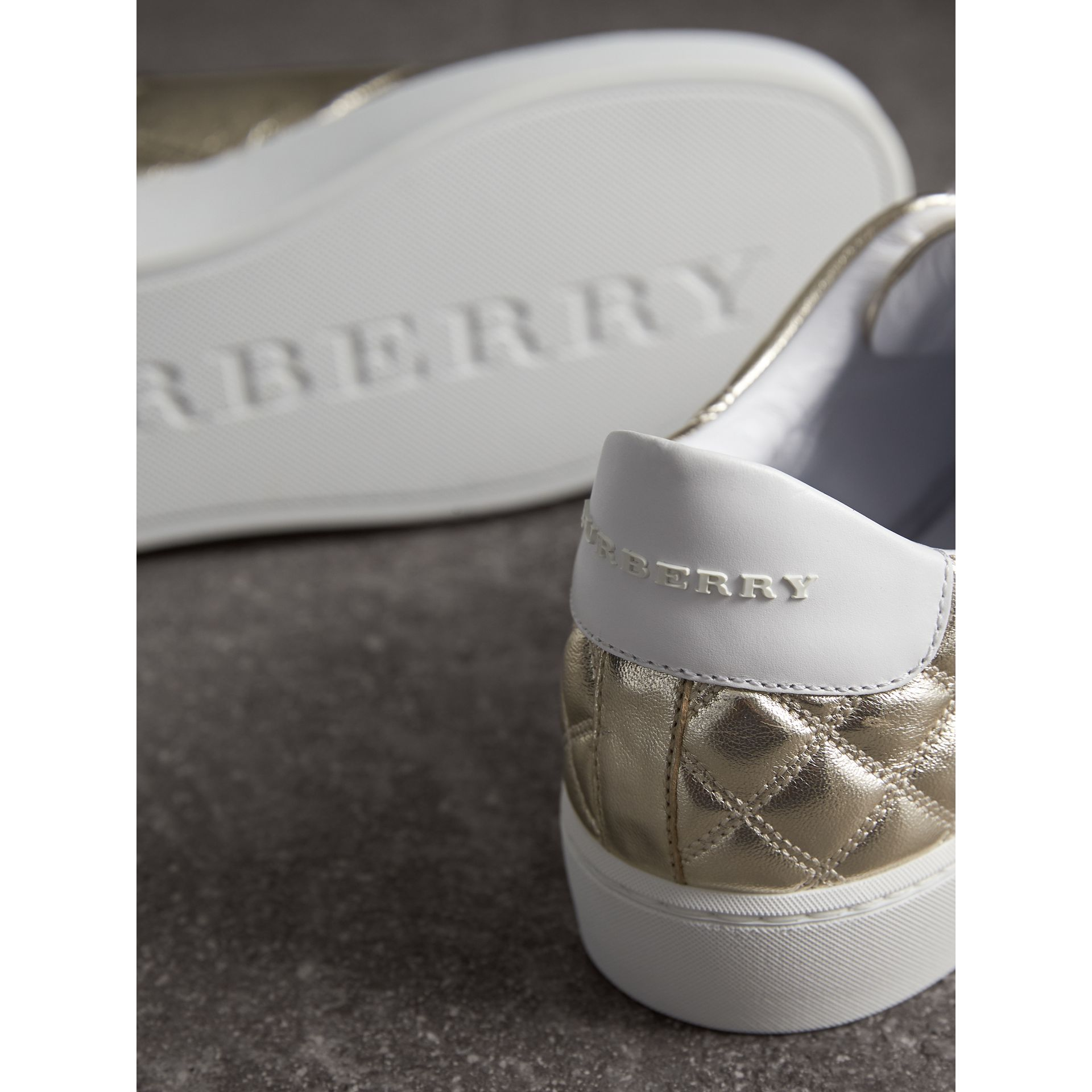 Metallic Check-quilted Leather Trainers in Light Gold - Women | Burberry Australia - gallery image 2