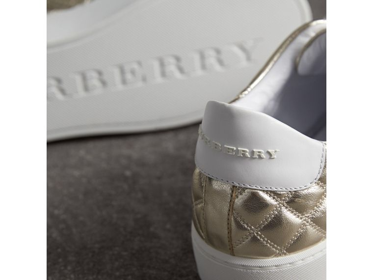 Metallic Check-quilted Leather Trainers in Light Gold - Women | Burberry Australia - cell image 1