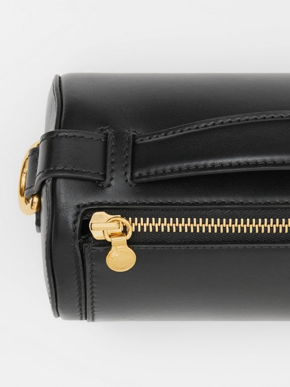 The Kingdom Motif Leather Barrel Bag in Black - Women | Burberry Australia - cell image 1