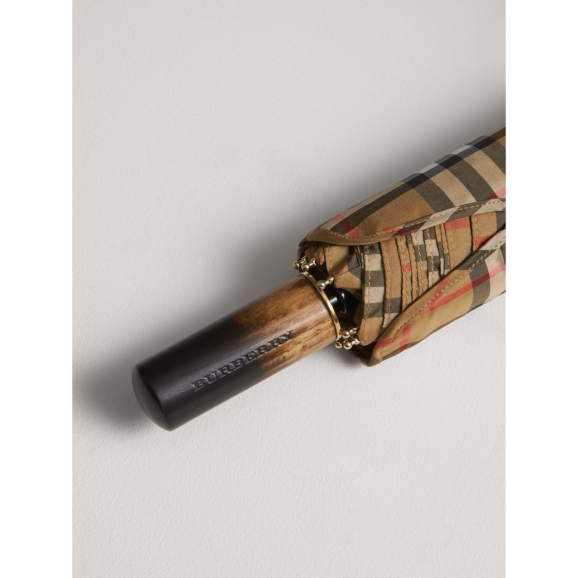Vintage Check Folding Umbrella in Antique Yellow | Burberry - gallery image 1