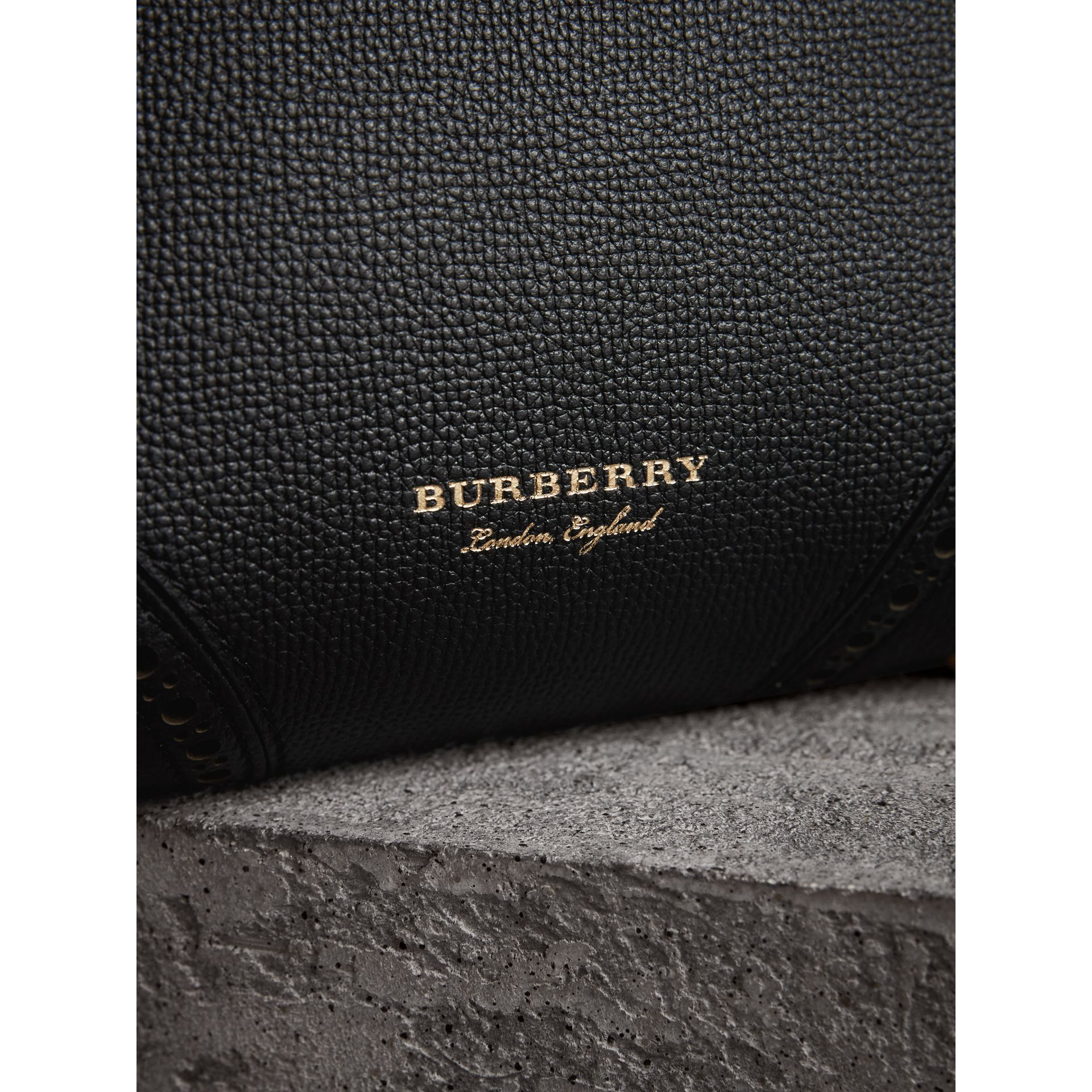 The Baby Banner in Brogue Detail Leather in Black - Women | Burberry United Kingdom - gallery image 1