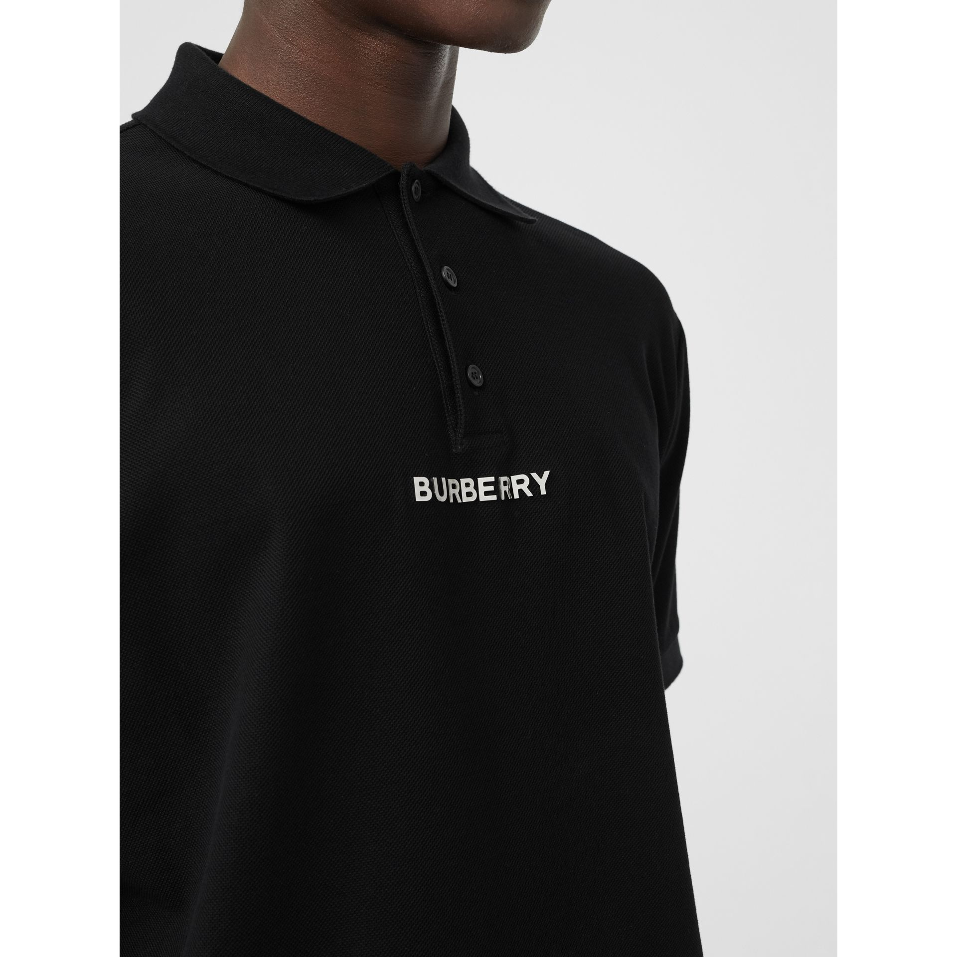 Embellished Logo Polo Shirt in Black - Men | Burberry - gallery image 1