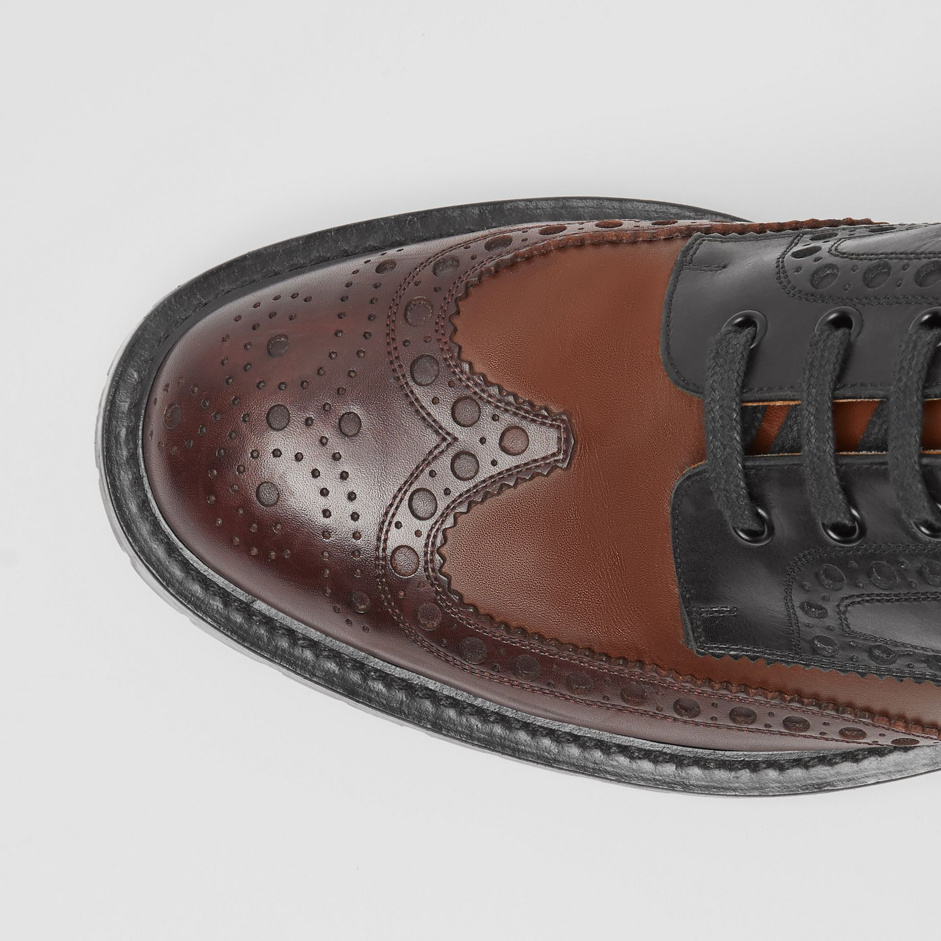 Brogue Detail Leather Boots in Black/garnet - Men | Burberry - gallery image 1