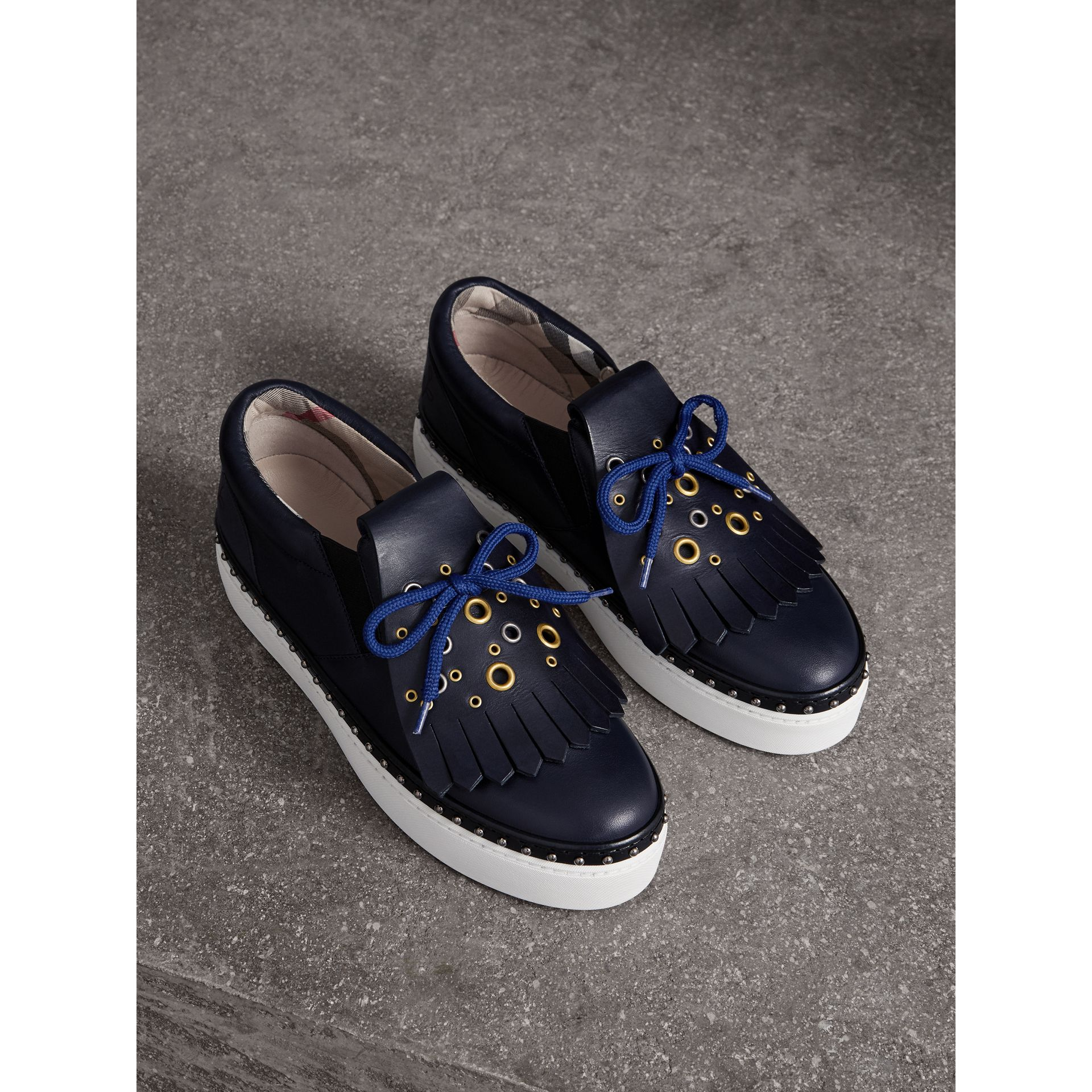 Kiltie Fringe Leather Trainers in Navy - Women | Burberry - gallery image 1