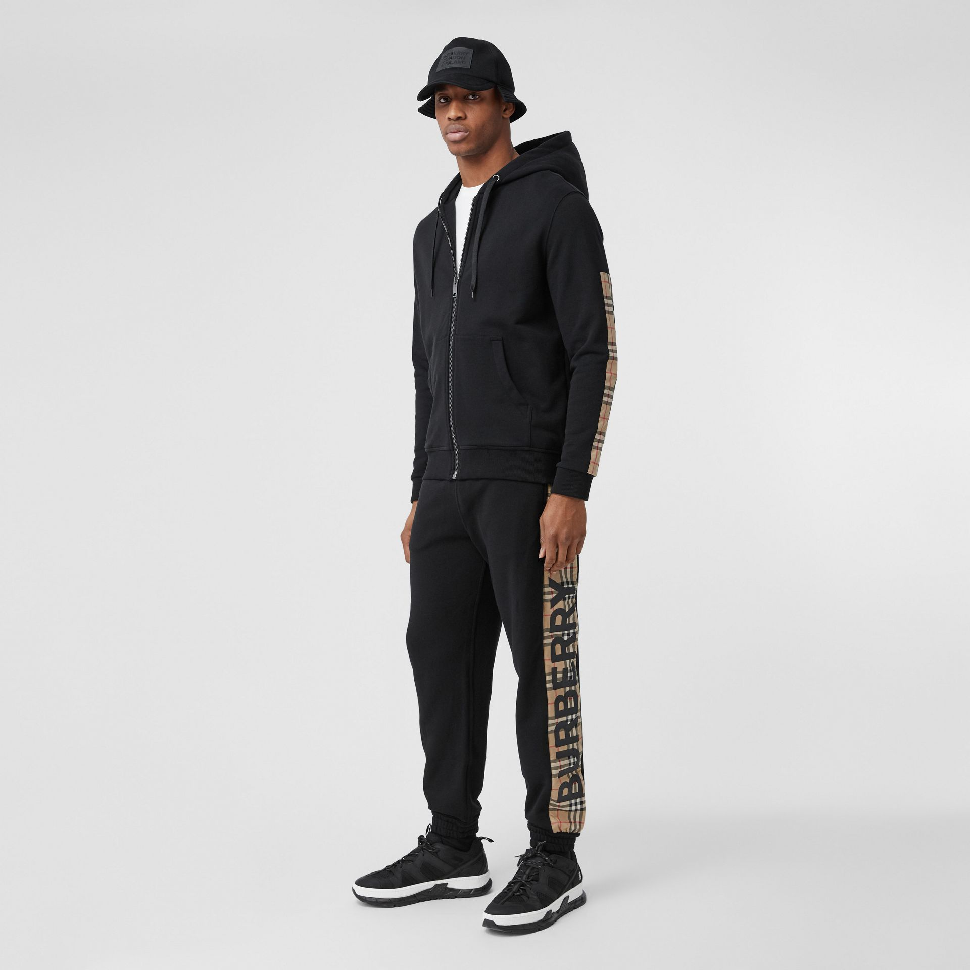Logo Print Check Panel Cotton Trackpants in Black - Men | Burberry - gallery image 0