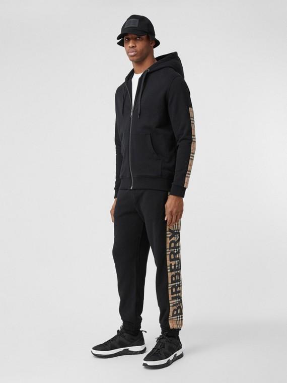 Track pants de algodão com recorte xadrez e estampa de logotipo (Preto)