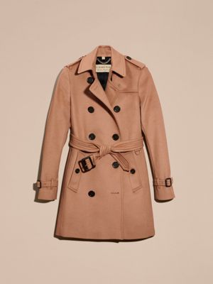Classic vintage Burberry belted trench coat in camel and belt with leather covered buckle. Interior lining in plaid cotton with a detachable zippered plaid wool lining layered on top of that.