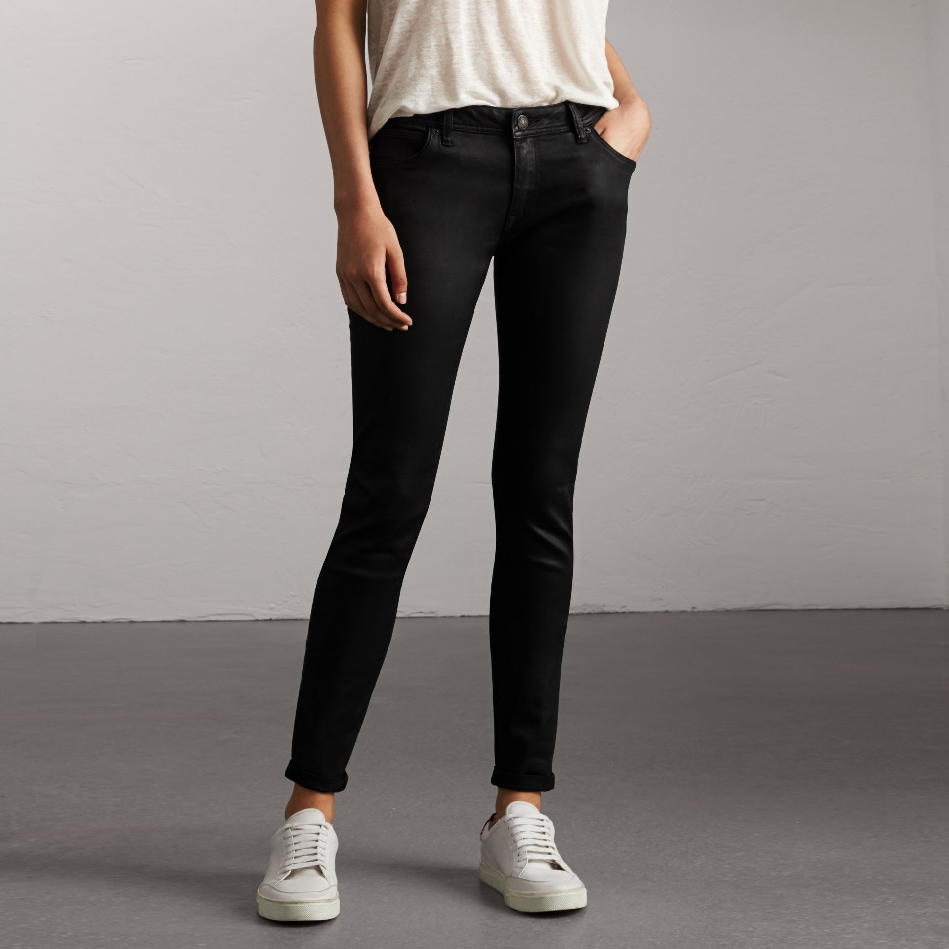 Skinny Fit Low-rise Wax Coated Jeans in Black - Women | Burberry - gallery image 0