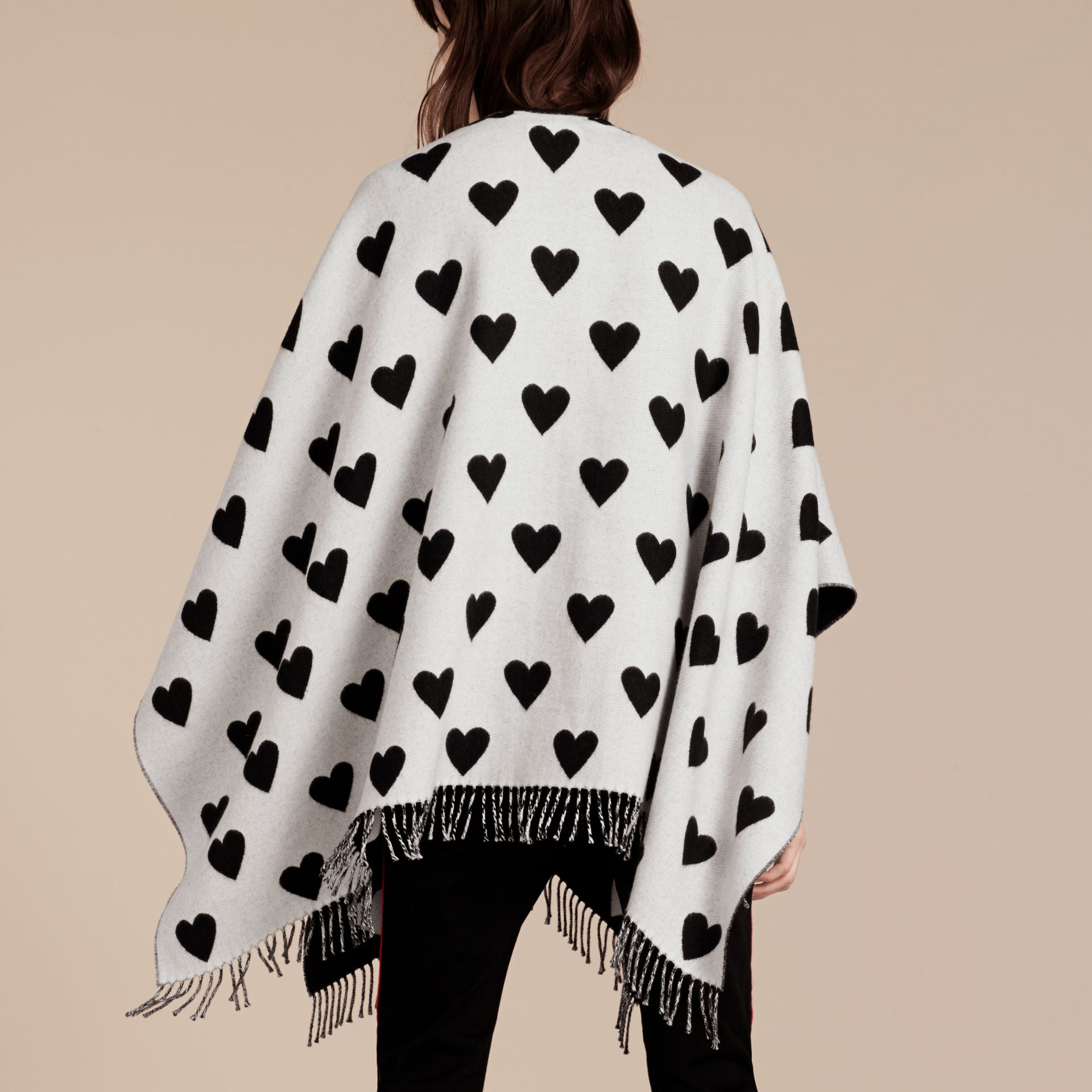 Heart Jacquard Merino Wool Poncho in Ivory/black - gallery image 3