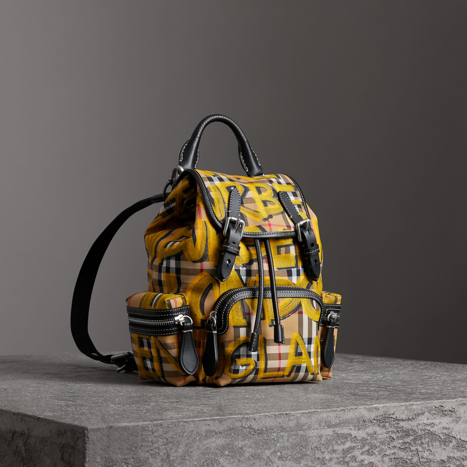 The Small Crossbody Rucksack in Graffiti Print Vintage Check in Black - Women | Burberry United Kingdom - gallery image 0