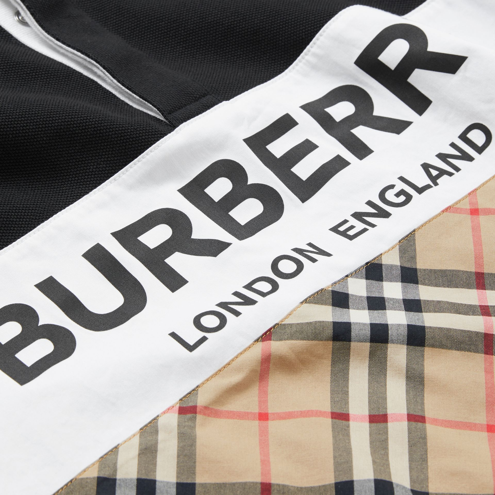 Long-sleeve Logo Print Check Panel Polo Shirt in Black | Burberry - gallery image 1