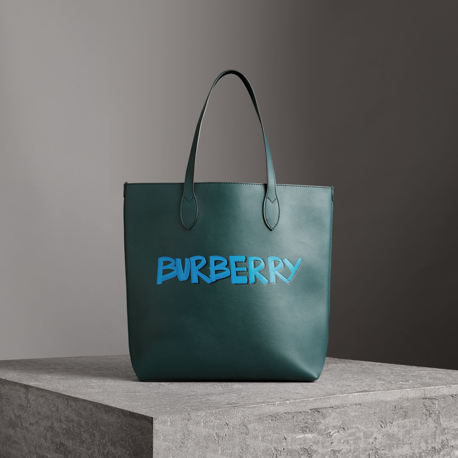 Graffiti Print Bonded Leather Tote in Deep Bottle Green | Burberry Canada - gallery image 0