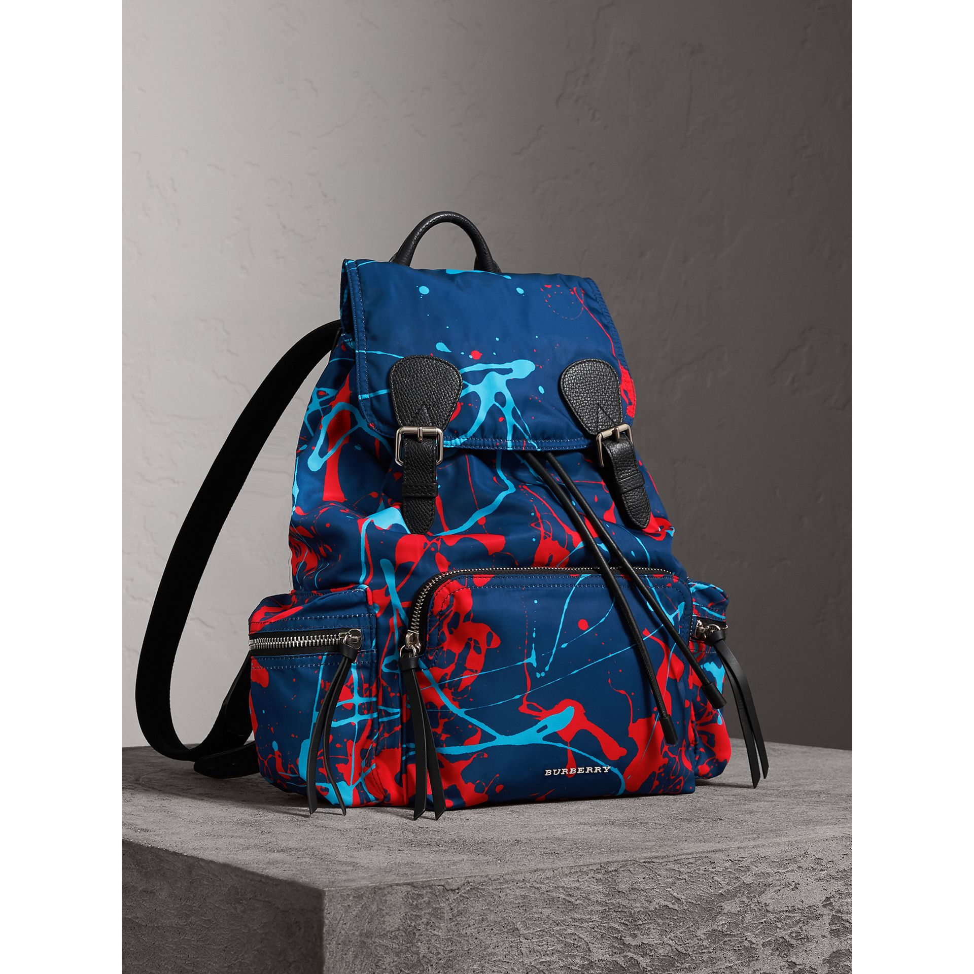 The Large Rucksack in Splash Print in Navy/orange | Burberry - gallery image 0