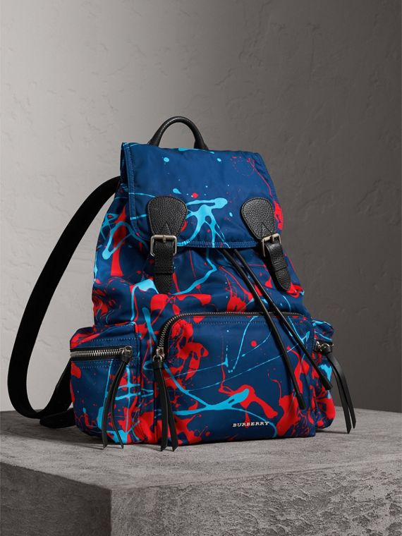 The Large Rucksack in Splash Print in Navy/orange