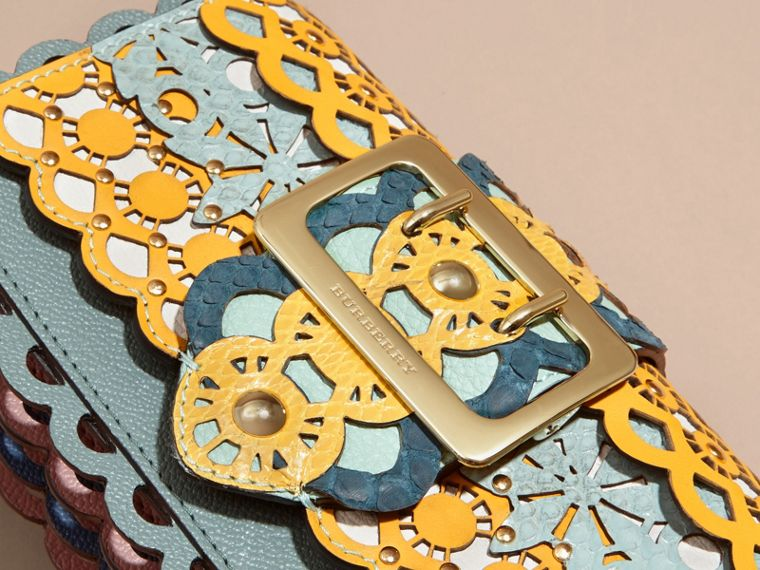 The Small Buckle Bag in Laser-cut Leather and Snakeskin - cell image 1