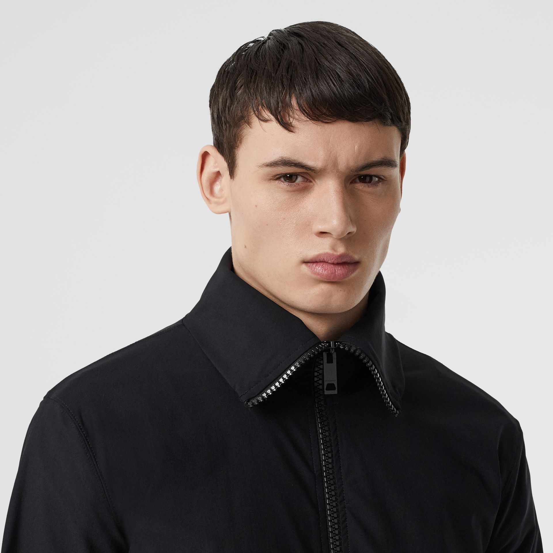 Logo Print Funnel Neck Track Top in Black - Men | Burberry - gallery image 1