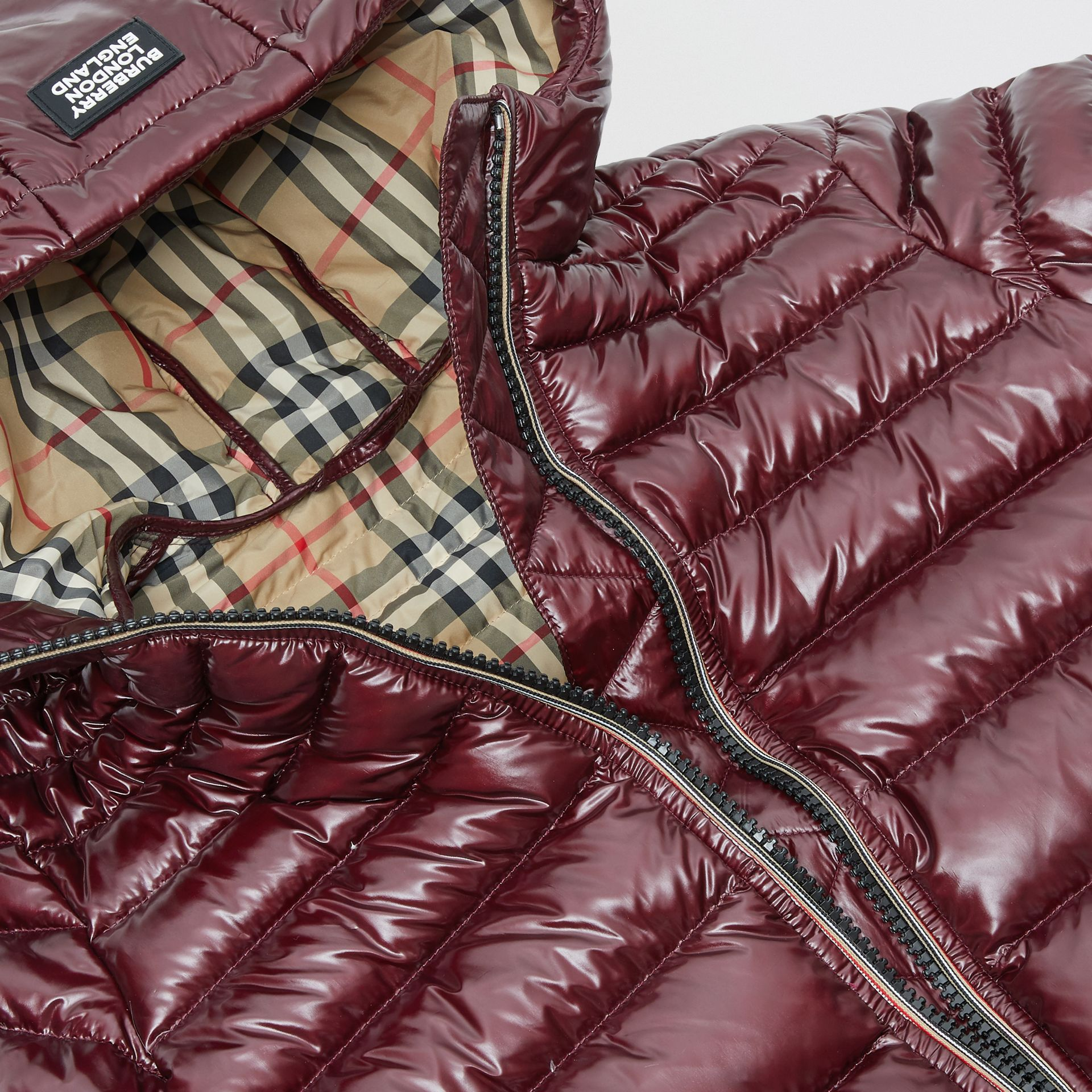 Icon Stripe Detail Down-filled Hooded Puffer Coat in Burgundy | Burberry Australia - gallery image 1