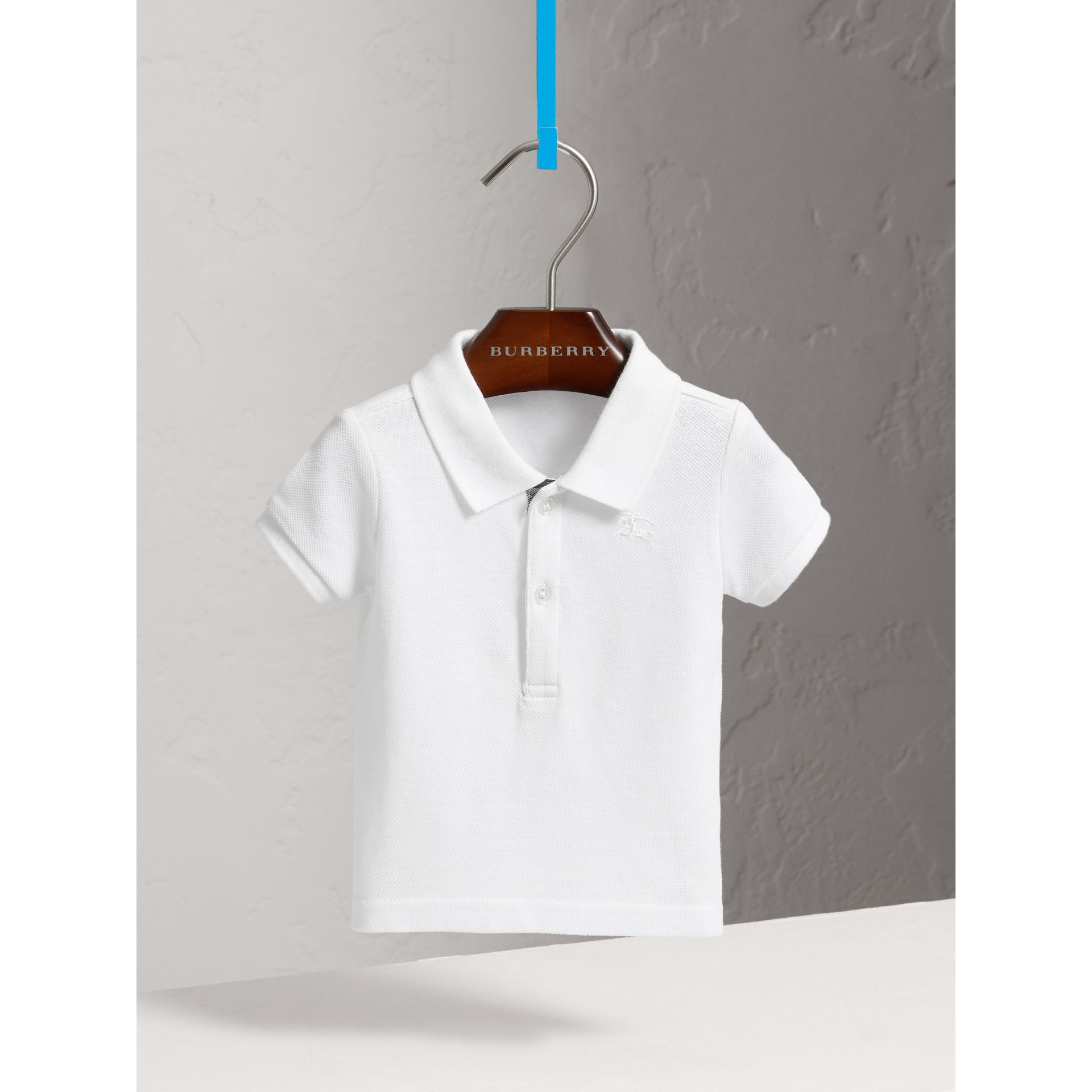 Cotton Piqué Polo Shirt in White | Burberry - gallery image 0