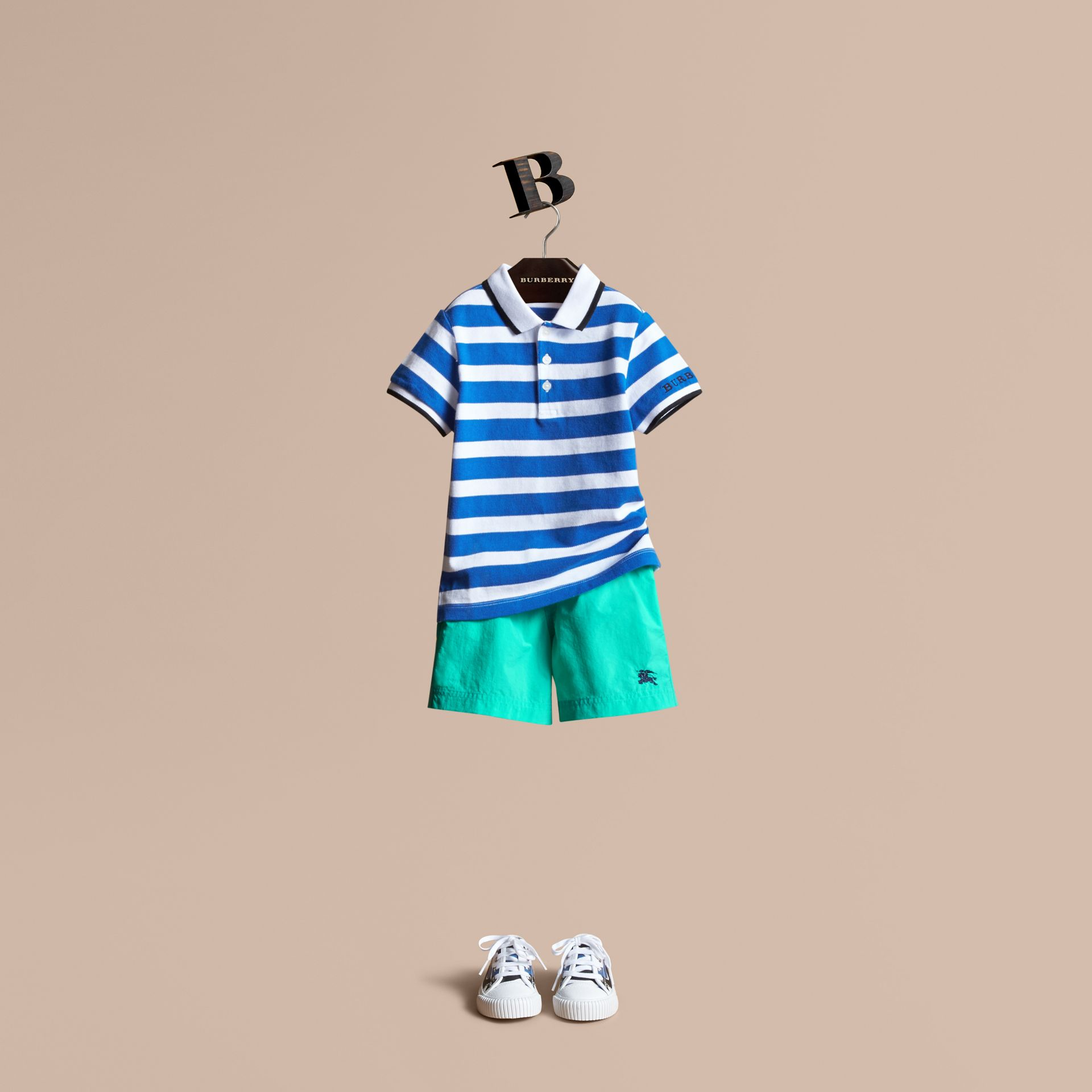 Striped Cotton Polo Shirt in Cerulean Blue | Burberry - gallery image 1