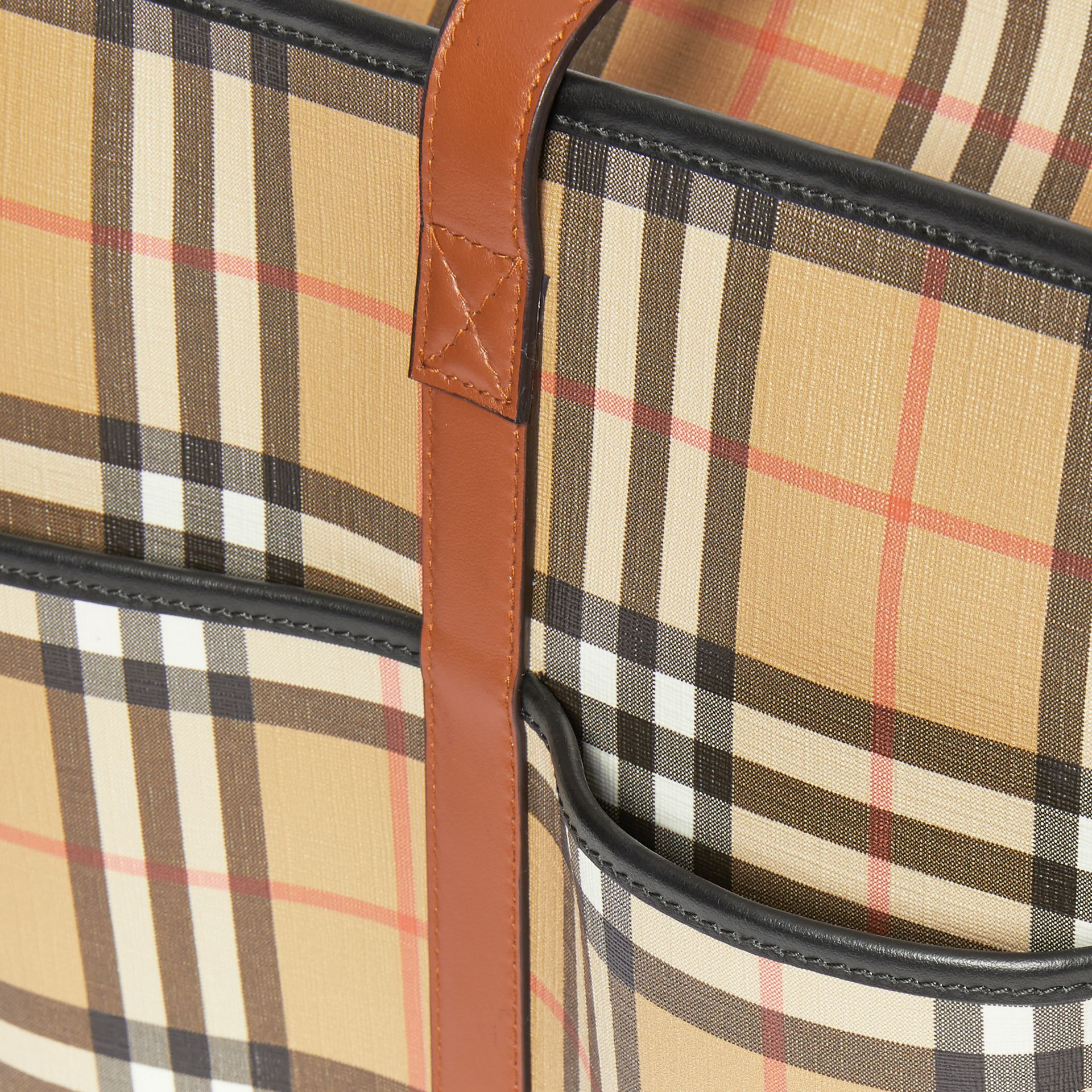 Vintage Check E-canvas Baby Changing Bag in Archive Beige - Children | Burberry United States - gallery image 1