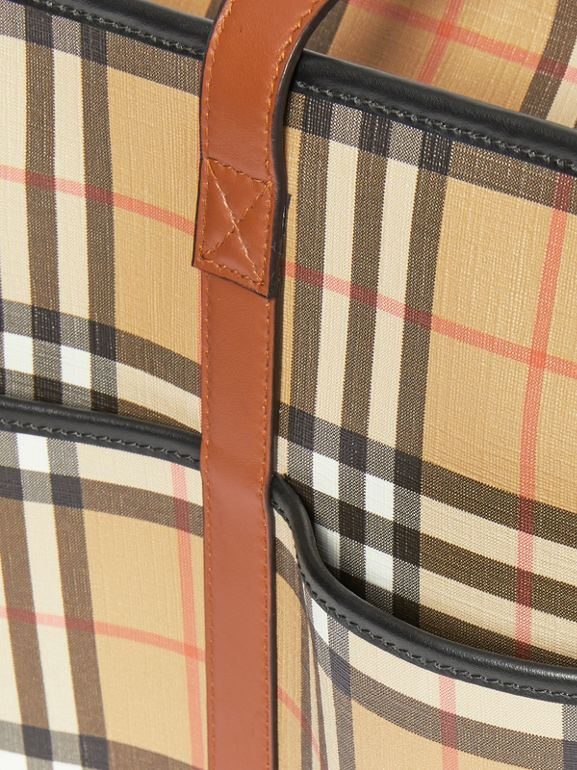 Vintage Check E-canvas Baby Changing Bag in Archive Beige - Children | Burberry United States - cell image 1