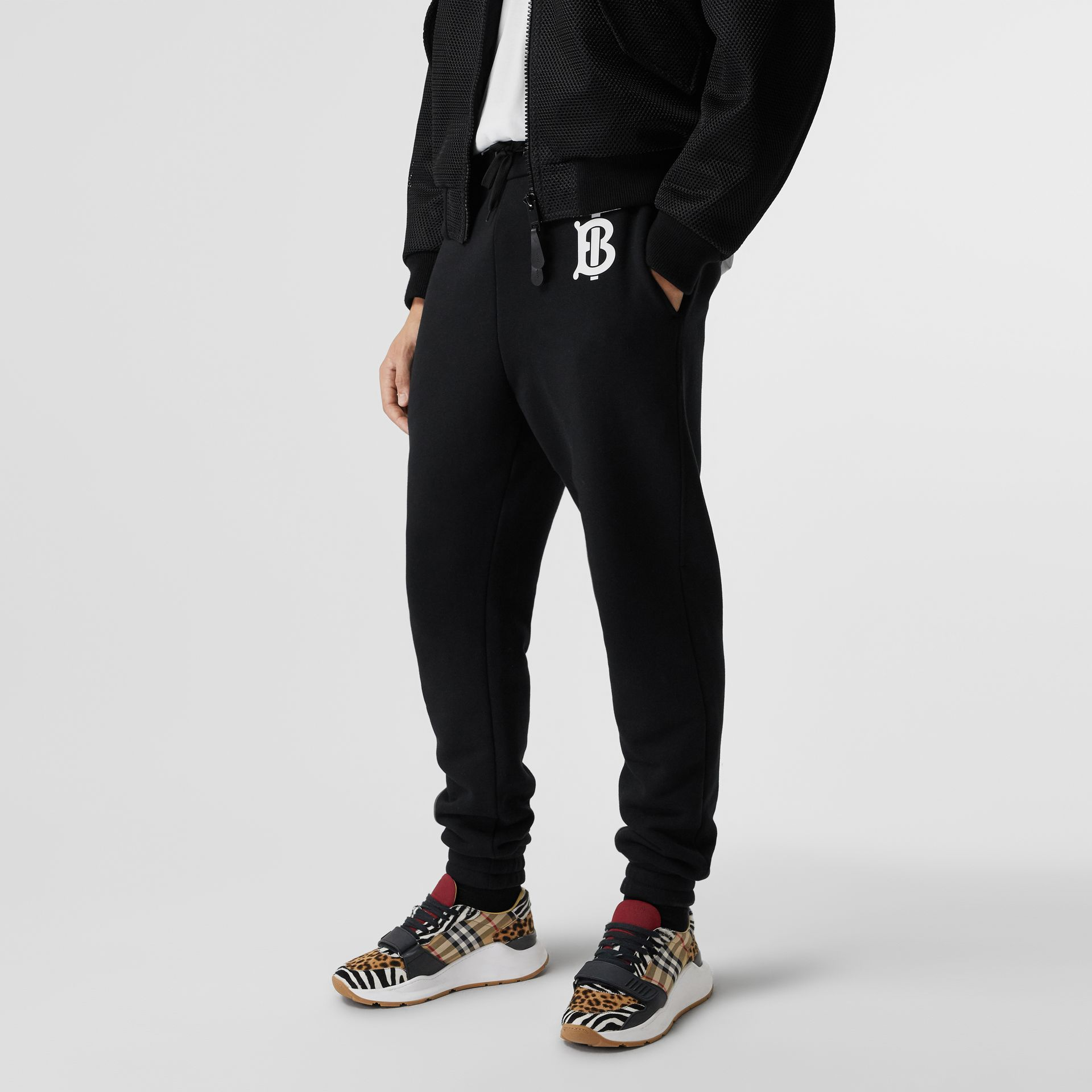 Monogram Motif Cotton Trackpants in Black - Men | Burberry United States - gallery image 4