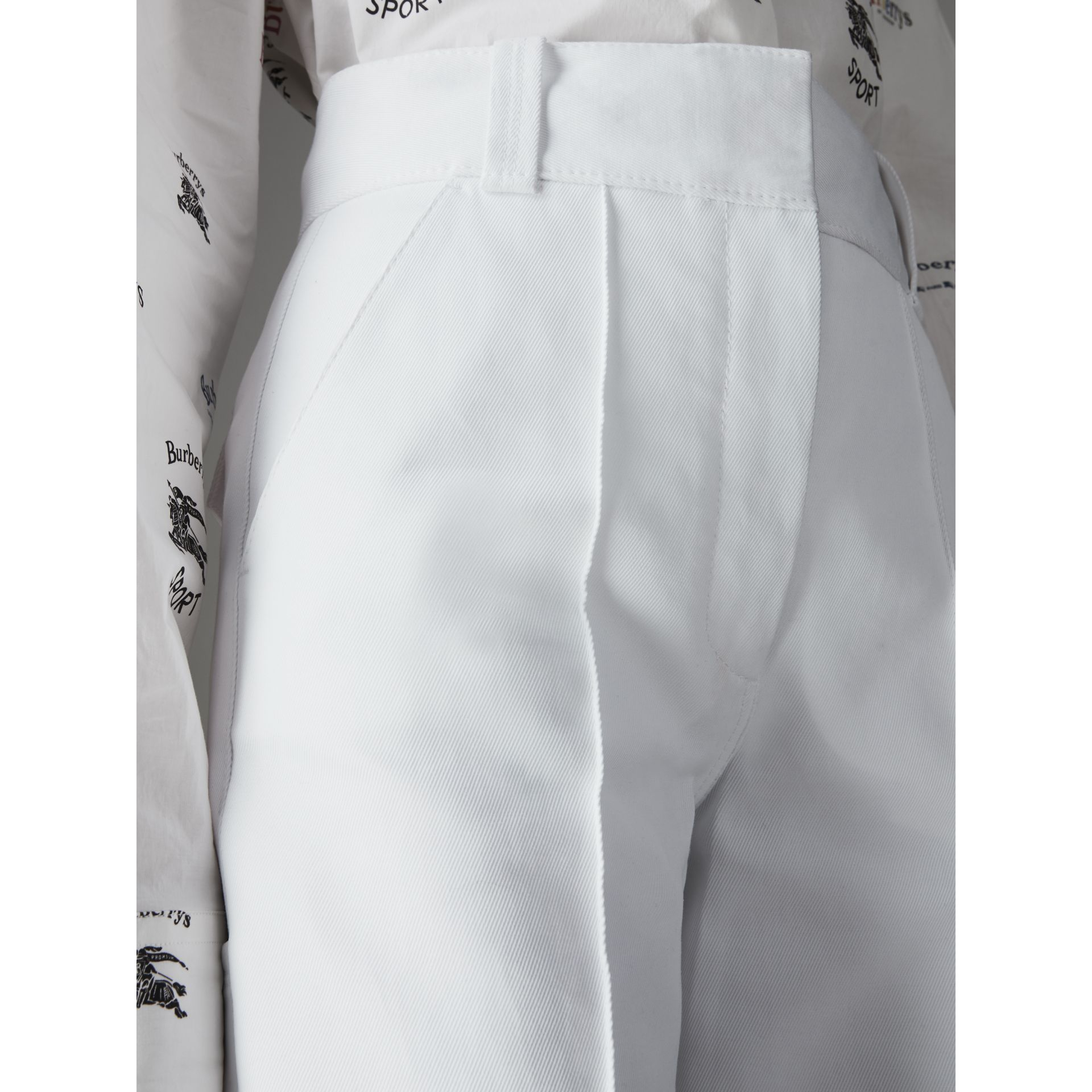 Cotton Drill High-waisted Trousers in White - Women | Burberry - gallery image 1