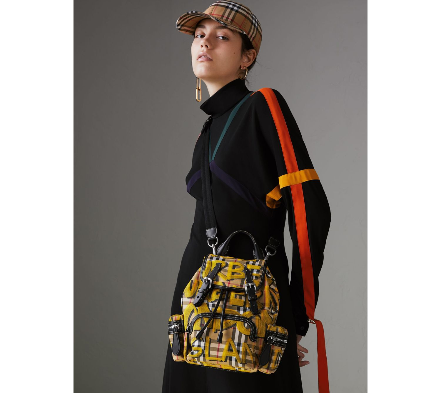The Small Crossbody Rucksack in Graffiti Print Vintage Check in Black