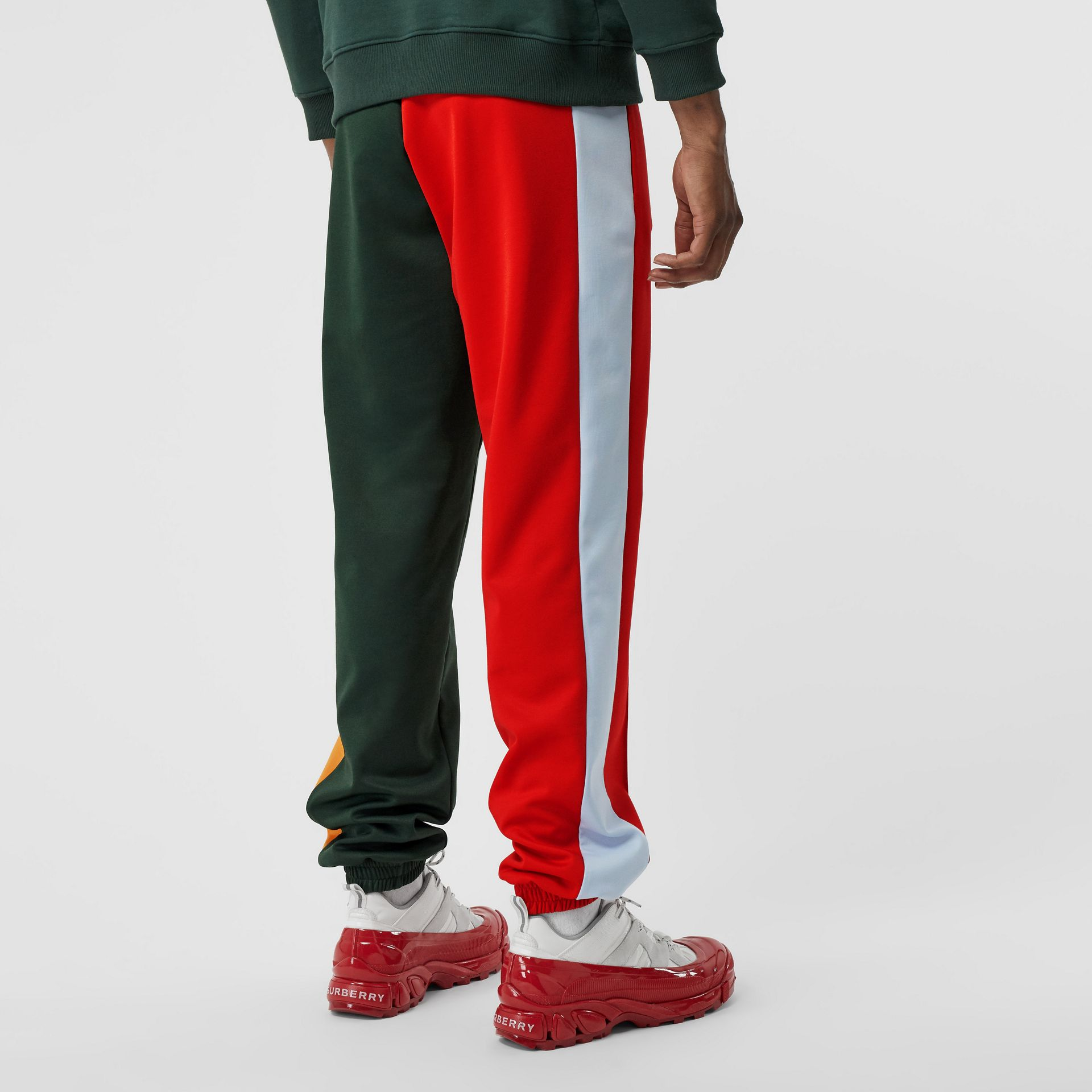 Logo Graphic Colour Block Jersey Trackpants in Dark Pine Green - Men | Burberry United Kingdom - gallery image 1