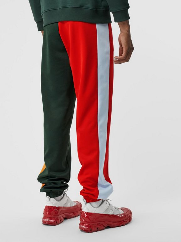 Logo Graphic Colour Block Jersey Trackpants in Dark Pine Green - Men | Burberry - cell image 1