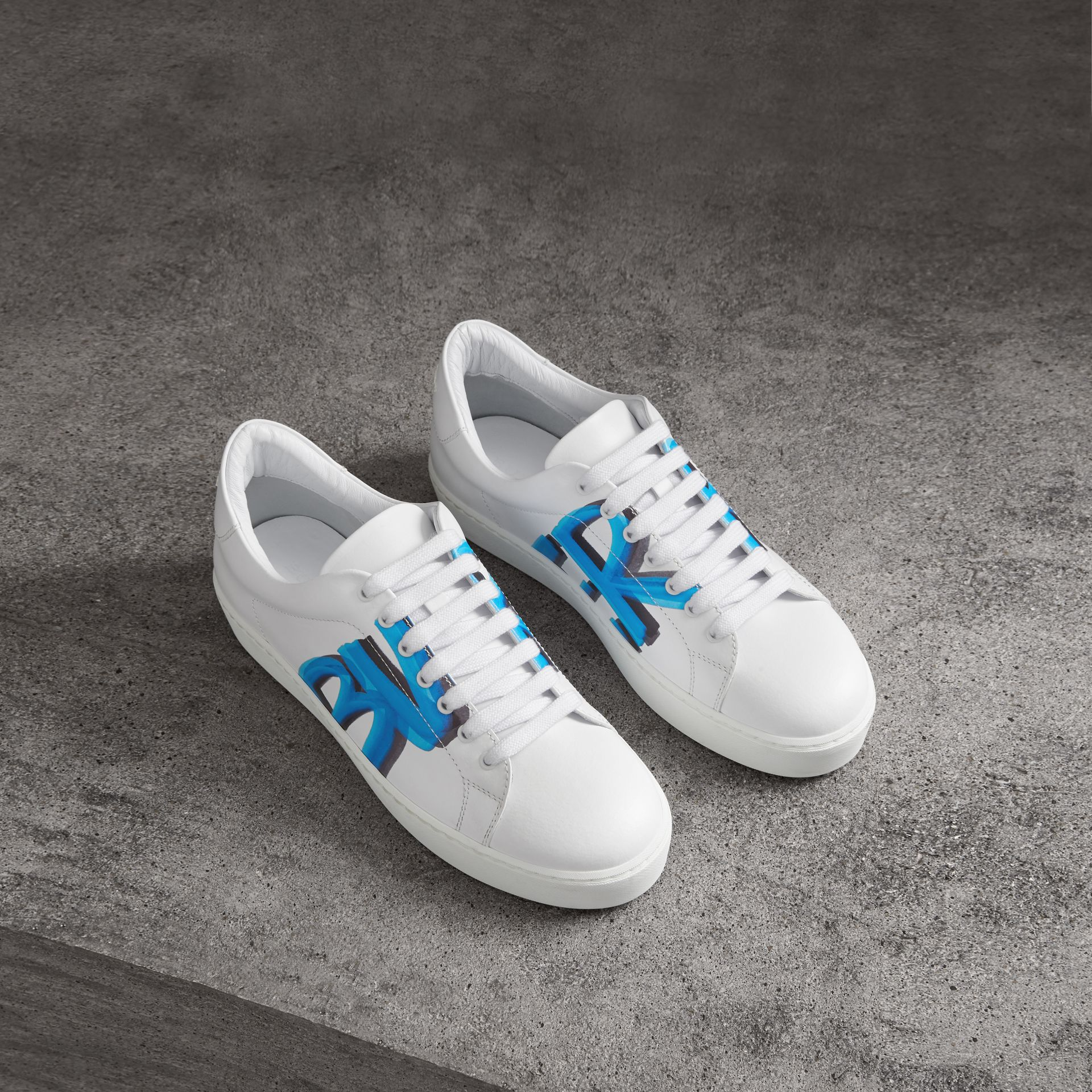 Graffiti Print Leather Sneakers in Bright Sky Blue - Women | Burberry Canada - gallery image 0