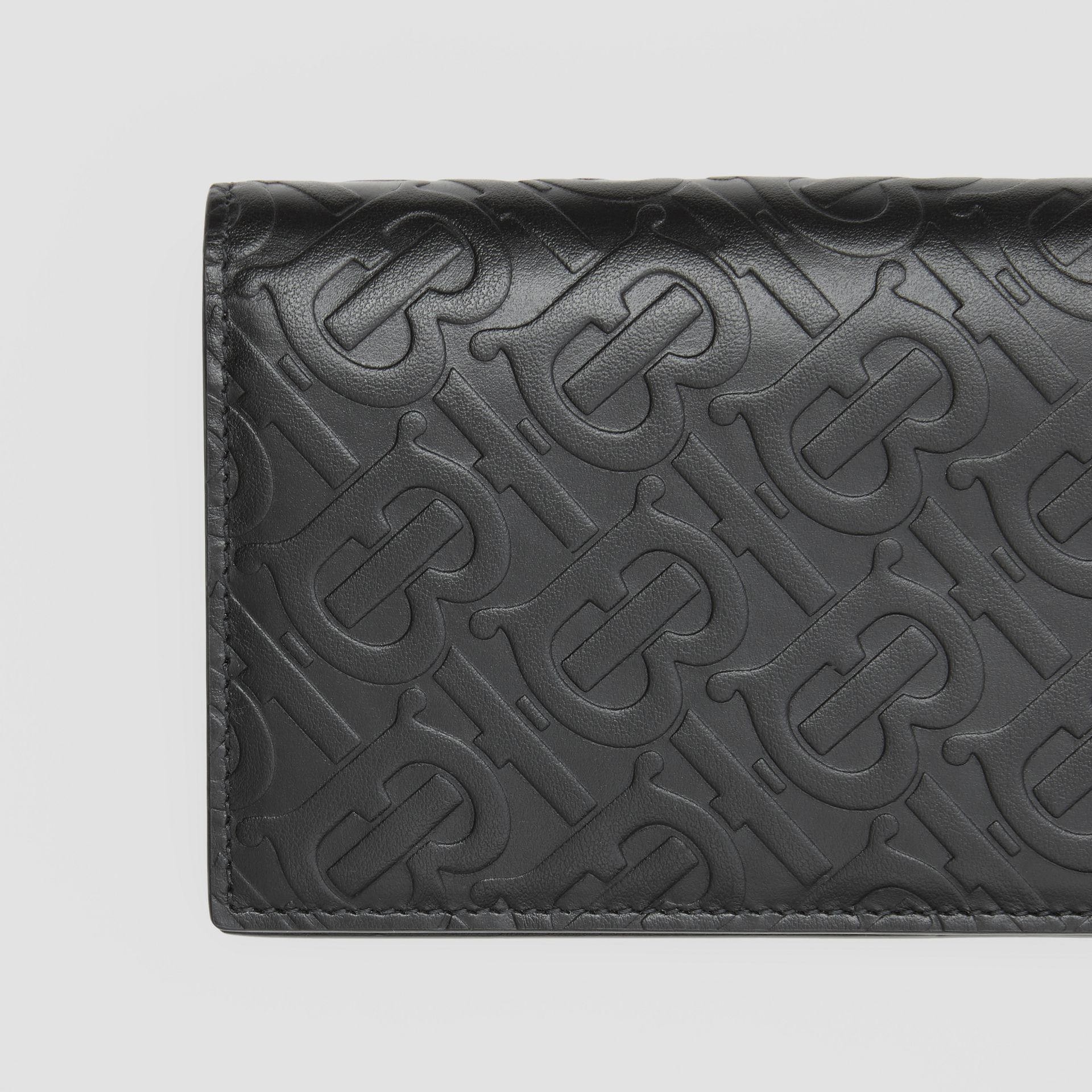 Monogram Leather Continental Wallet in Black - Men | Burberry United Kingdom - gallery image 1