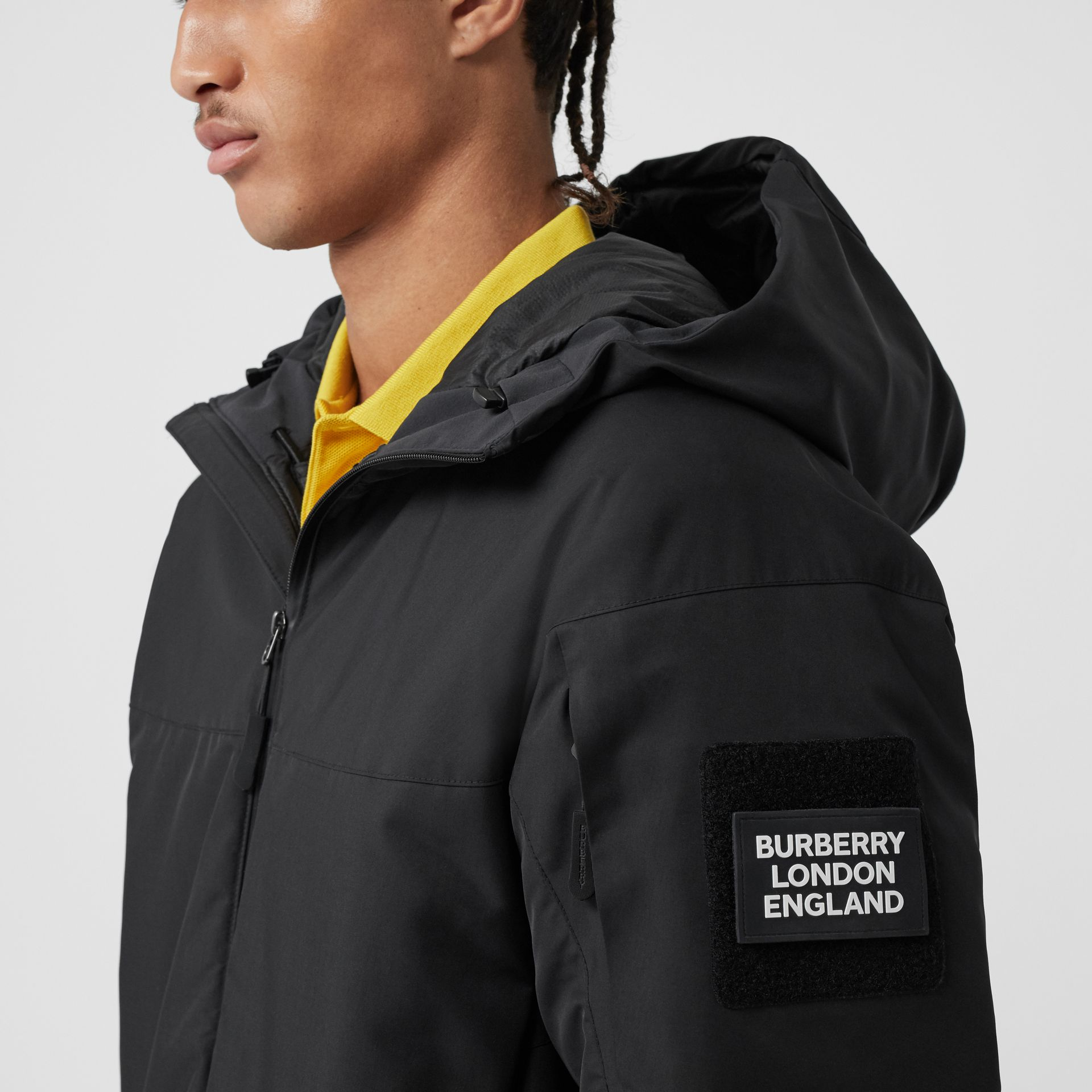 Logo Graphic Recycled Polyester Hooded Jacket in Black - Men | Burberry United Kingdom - gallery image 1