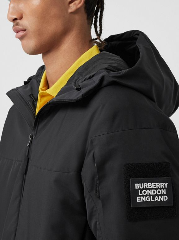 Logo Graphic Recycled Polyester Hooded Jacket in Black - Men | Burberry United Kingdom - cell image 1