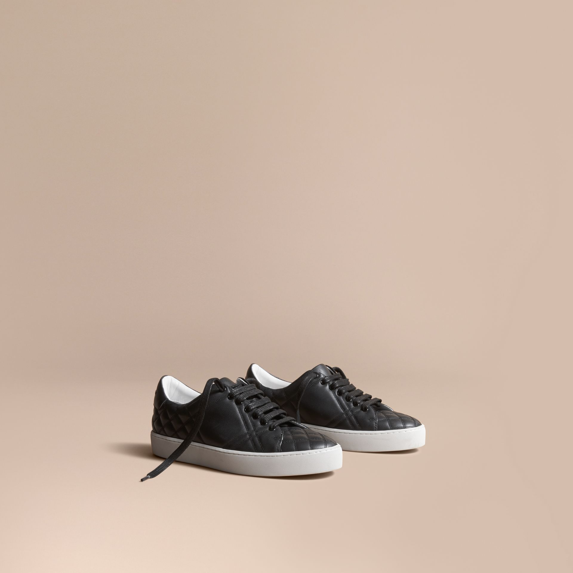 Check-quilted Leather Trainers in Black - Women | Burberry United States - gallery image 1