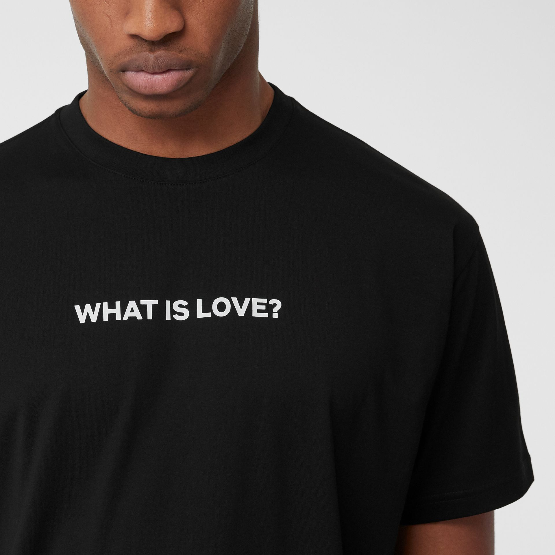 Love Slogan Cotton Oversized T-shirt in Black - Men | Burberry United Kingdom - gallery image 1