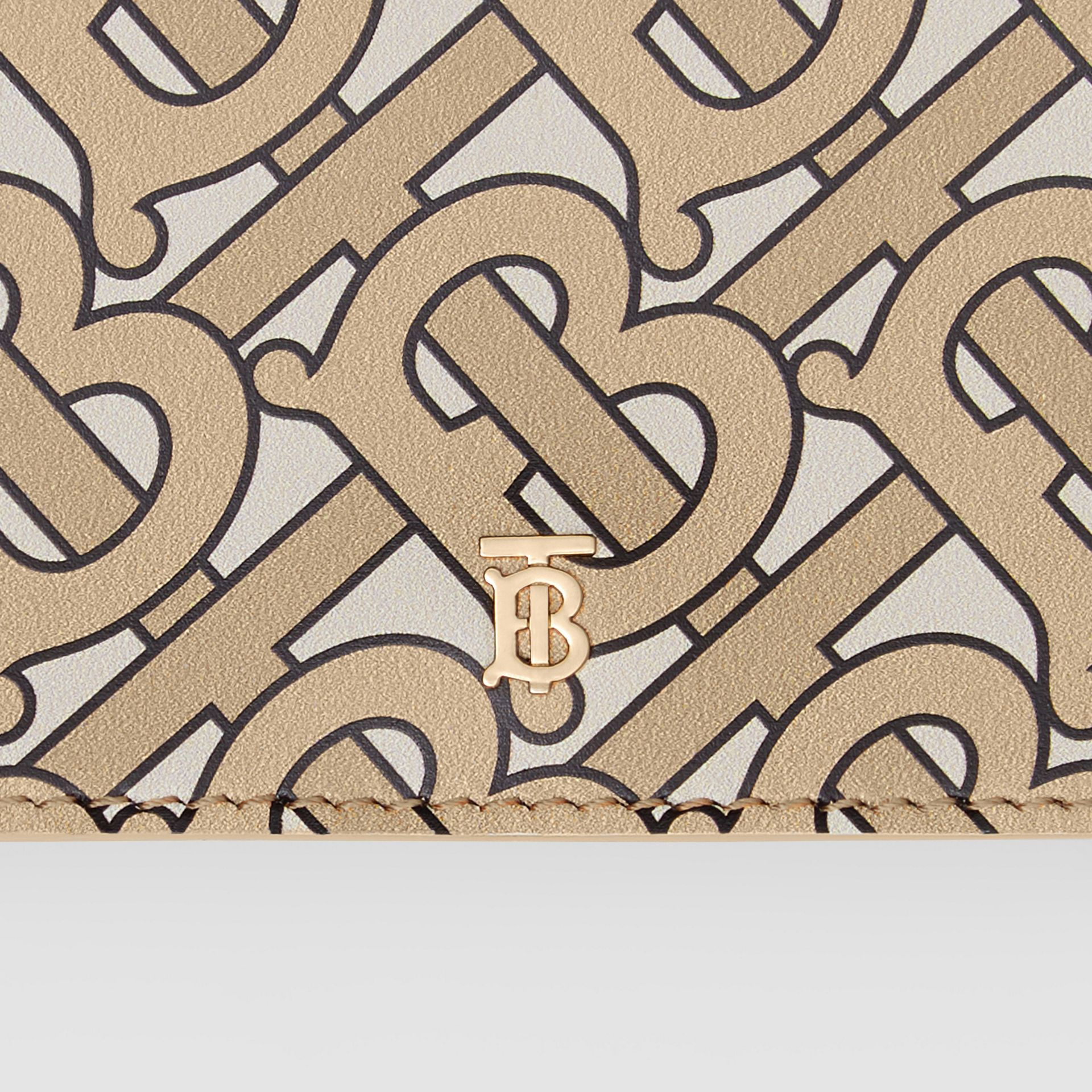 Small Monogram Print Leather Folding Wallet in Beige | Burberry United Kingdom - gallery image 1