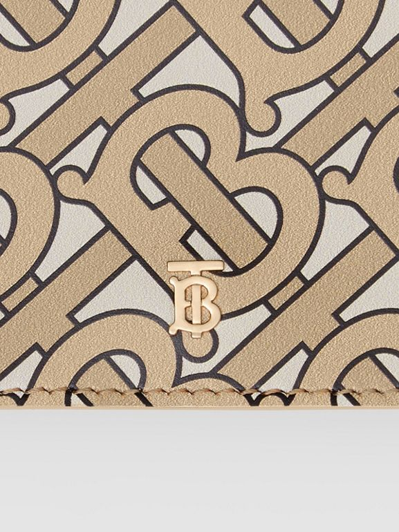 Small Monogram Print Leather Folding Wallet in Beige | Burberry United Kingdom - cell image 1