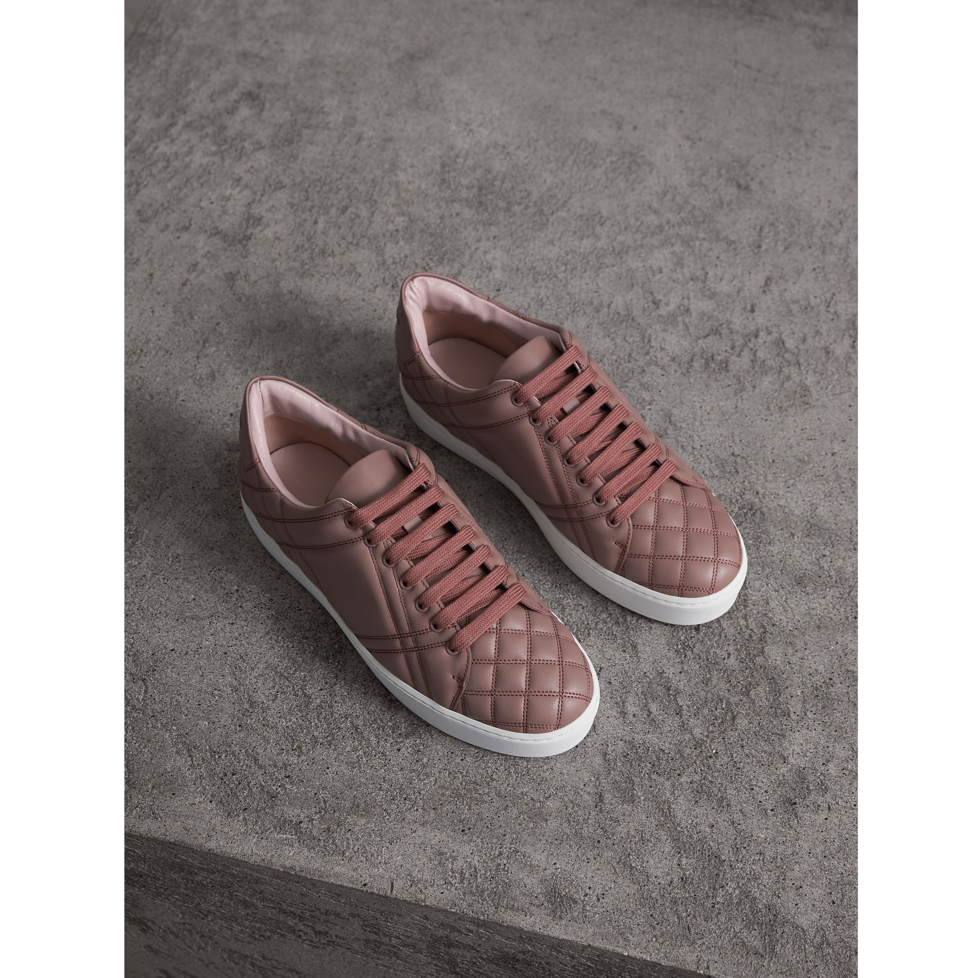 Check-quilted Leather Trainers in Ivory Pink - Women | Burberry - gallery image 0