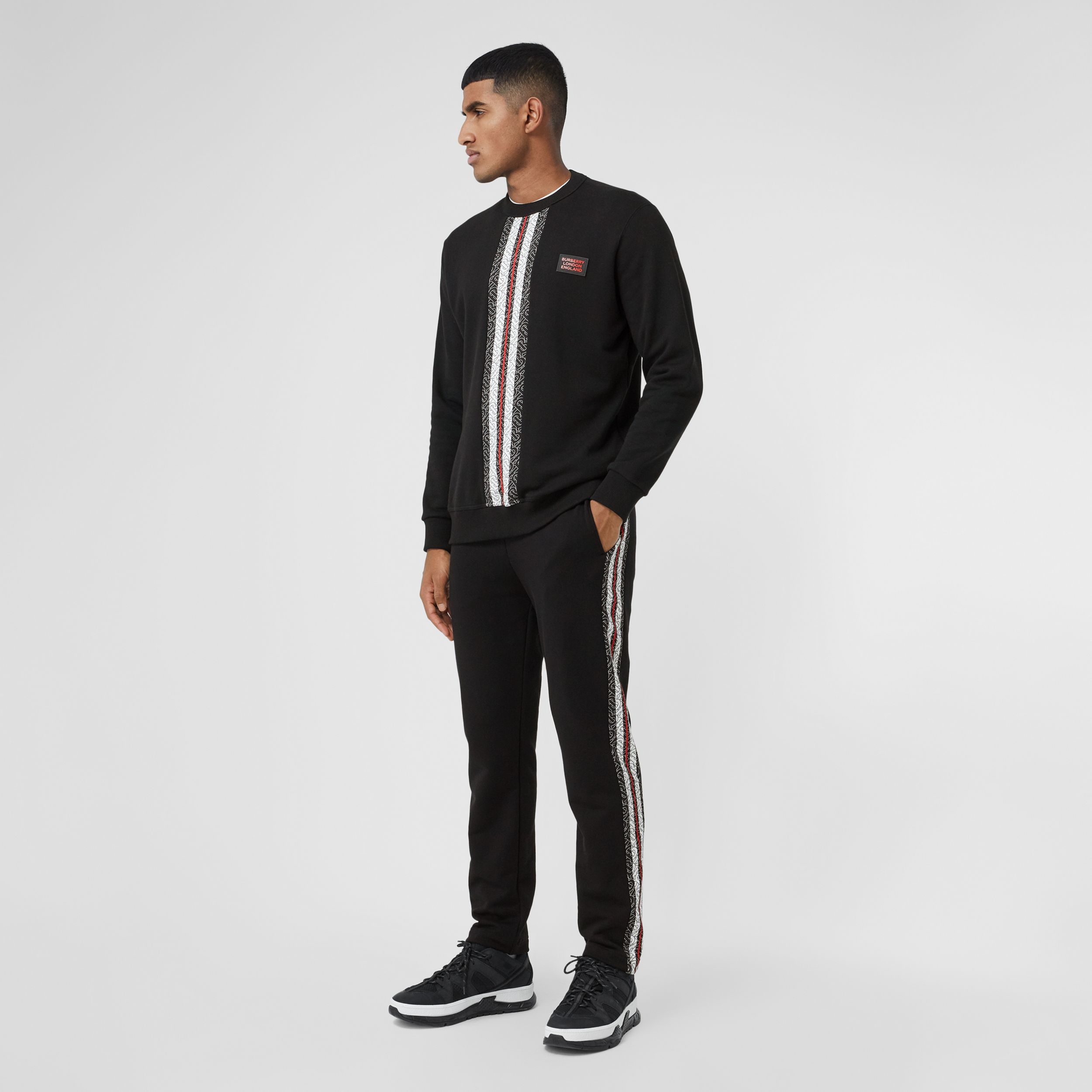 Monogram Stripe Panel Cotton Jogging Pants in Black - Men | Burberry Hong Kong S.A.R. - 1