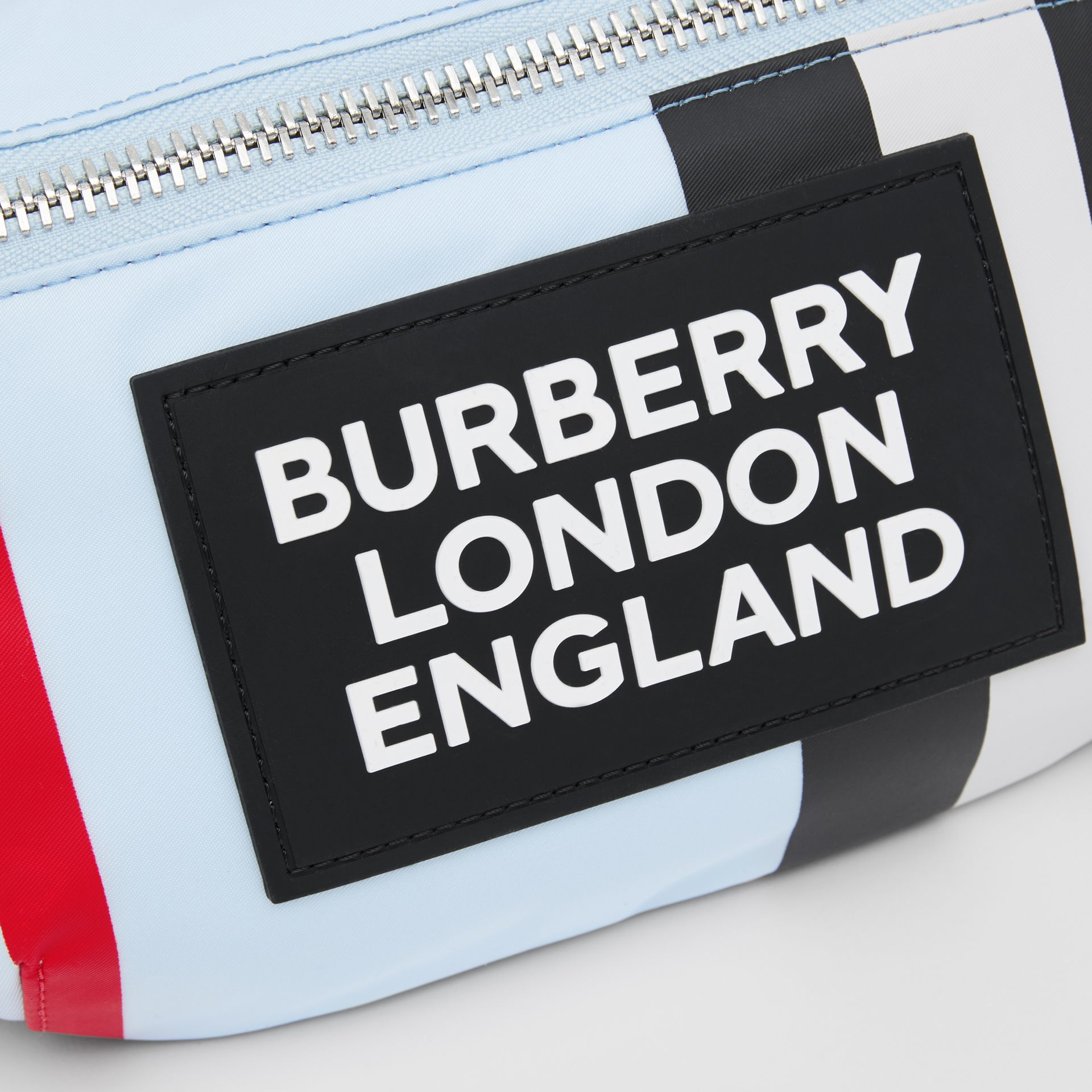 Logo Appliqué Icon Stripe ECONYL® Bum Bag in Pale Blue - Children | Burberry United Kingdom - gallery image 1