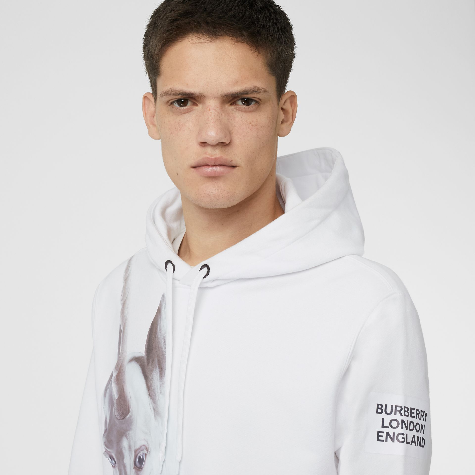 Unicorn Print Cotton Hoodie in White - Men | Burberry - gallery image 1