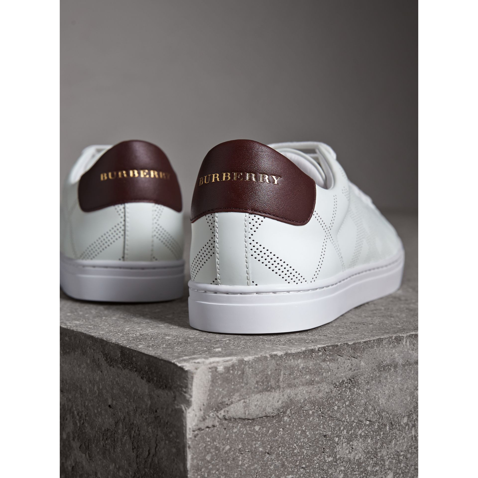 Perforated Check Leather Trainers in Optic Whit/deep Claret - Men | Burberry - gallery image 2