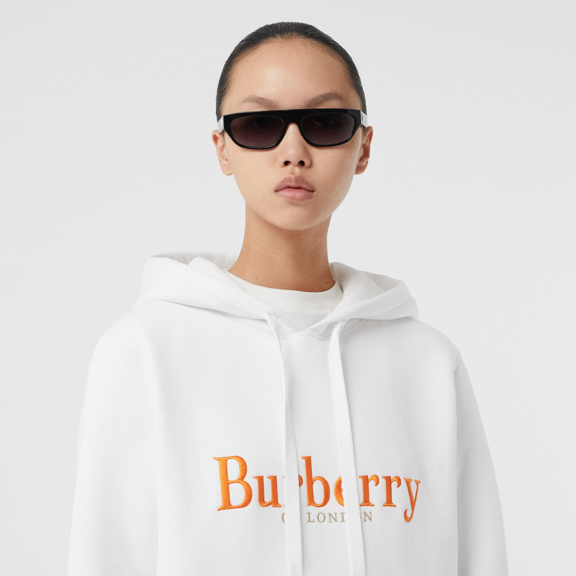 Embroidered Archive Logo Jersey Hoodie in White - Women | Burberry United Kingdom - gallery image 1