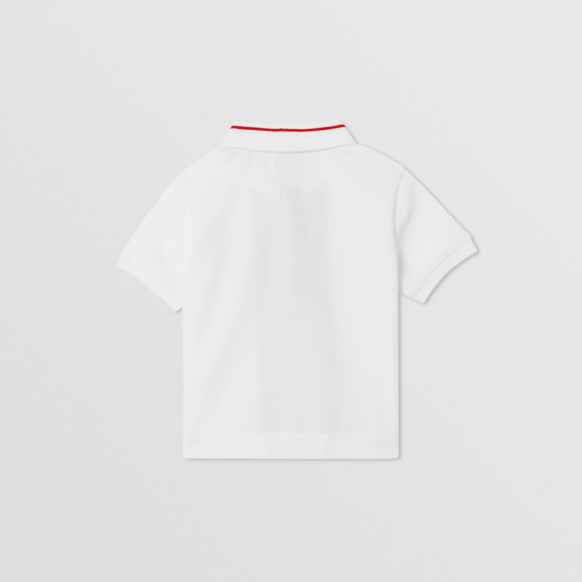 Monogram Stripe Cotton Piqué Polo Shirt in White - Children   Burberry - gallery image 3