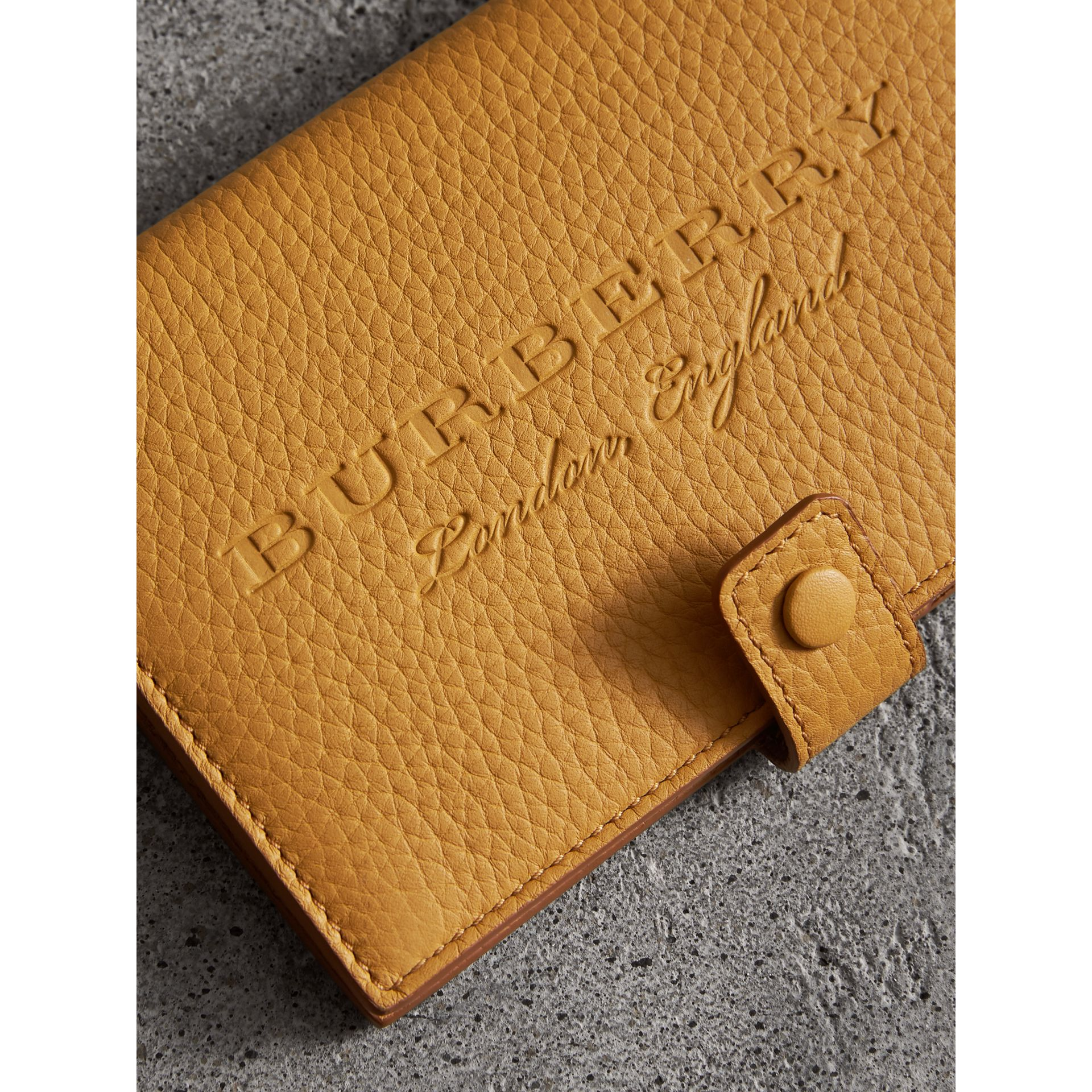 Embossed Grainy Leather Folding Wallet in Ochre Yellow - Women | Burberry - gallery image 1