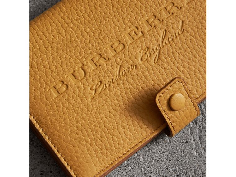 Embossed Grainy Leather Folding Wallet in Ochre Yellow - Women | Burberry - cell image 1